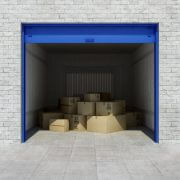 Open self storage unit full of cardboard boxes. 3d rendering
